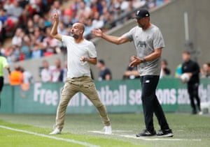 Liverpool manager Jürgen Klopp (right) and Manchester City manager Pep Guardiola instruct their players during the 2019 Community Shield match.
