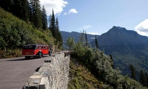 A Glacier national park tour bus ascends the Going-To-The-Sun road to Logan Pass.