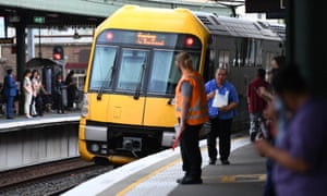 Commuters on a platform at Strathfield train station in Sydney.