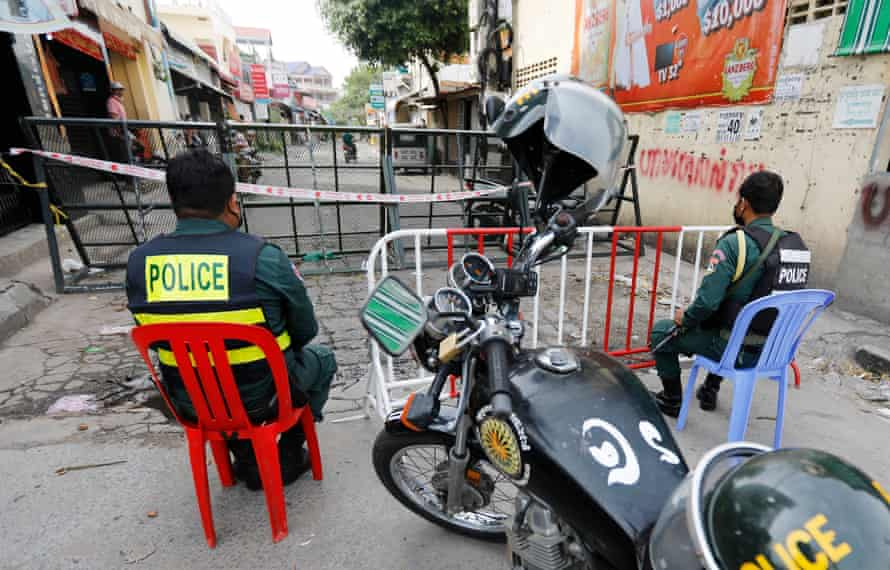 Police guard a blocked street in Phnom Penh.