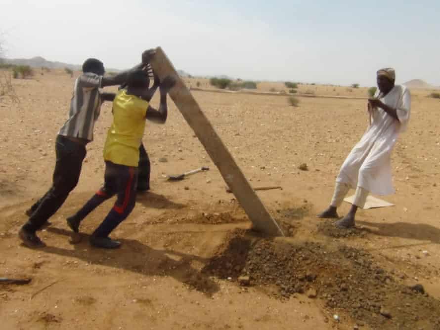 Installing concrete post for pastoralists