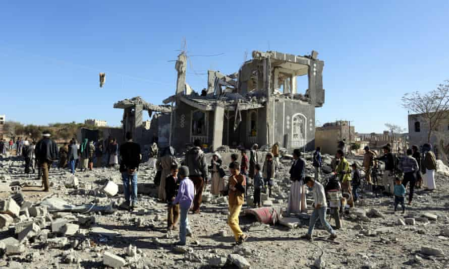 People survey the damage after an alleged Saudi-led airstrike in Sana'a
