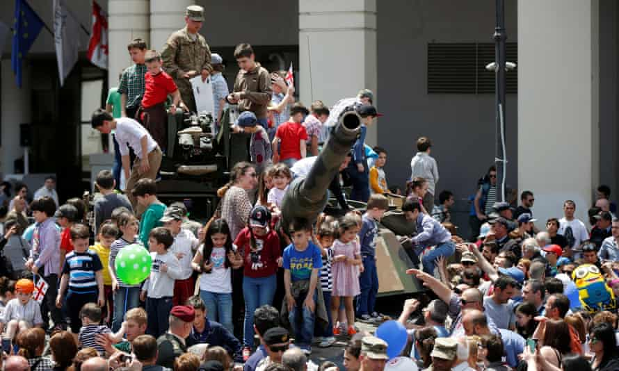 Children play atop a tank during Independence Day celebration in Tbilisi at the weekend.