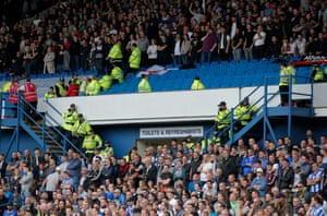 Police keep a close guard on thehome fans on the Lower Leppings Lane and away fans above.
