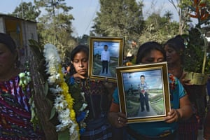 San Juan Sacatepéquez, Guatemala Mourners carry the portraits of Daniel Xiquin (left) and Oscar Cotzajay. The boys, aged 10 and 11, were abducted as they were walking to school in their village of Cerro Alto. They were later killed by their kidnappers