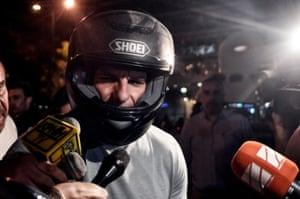 Greek Finance Minister Yanis Varoufakis leaves his office last night.