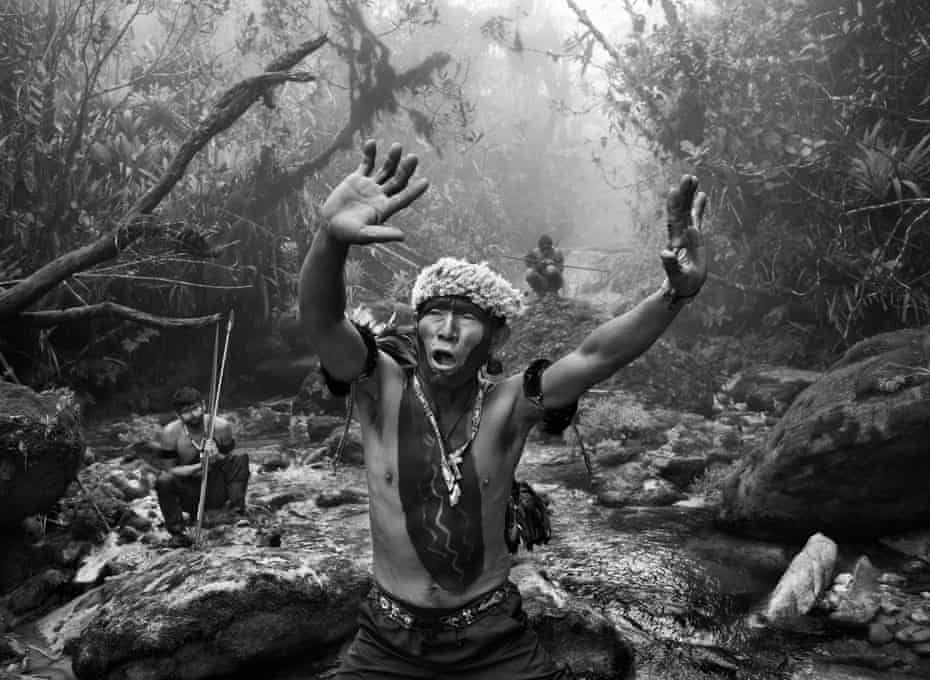A Yanomami shaman performing a ritual the state of Amazonas, Brazil, in 2014.