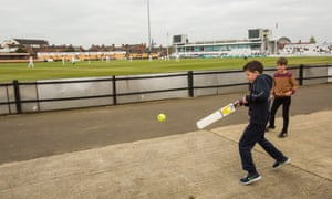 Children play their own game around the edge of the County Ground.