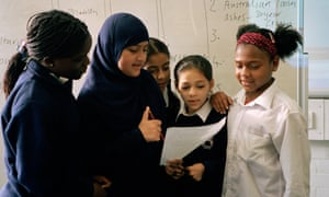 Pupils at Millfields community primary school in East London take part in a workshop on African values and culture as part of Black History Month