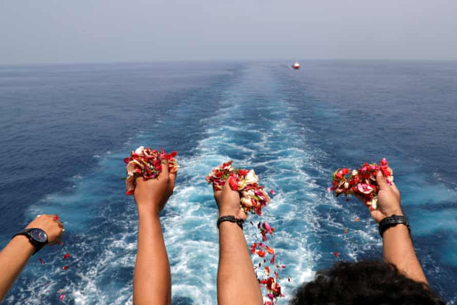 Families and colleagues of passengers and crew who died on Lion Air flight 610 pay tribute at the site of the crash