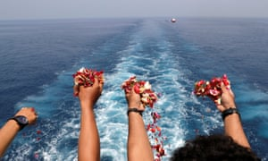 Families and colleagues of passengers and crew of Lion Air flight JT610 throw flowers and petals from the deck of Indonesia Navy ship KRI Banjarmasin as they visit the site of the crash to pay their tribute
