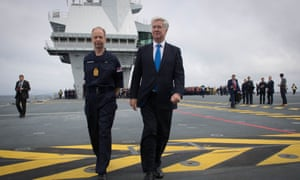 Sir Michael Fallon, the defence secretary, accompanied by Commanding Officer Captain Jerry Kyd, on board HMS Queen Elizabeth as the Royal Navy's new aircraft carrier sets sail from Lossiemouth for the latest in a series of sea trials.