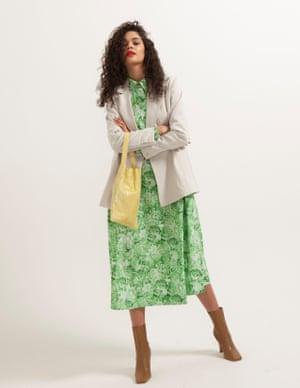 model wears dress, £215, ganni.com. Blazer, £55, weekday.com. Boots, £99.99, zara.com. Bag, £265, by TL180, from harveynichols.co.uk.