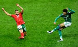 Northern Ireland's Jamal Lewis slots the ball past Bulgaria's Georgi Yomov.
