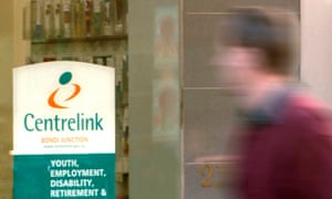 A pedestrian walks past a Centrelink employment office in Bondi Junction.