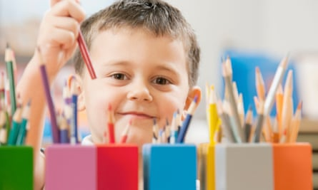 Child picking up a pencil