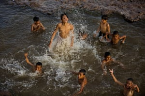 Islamabad, Pakistan - Children play in a stream polluted by sewage in a suburb of the capital