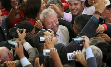 Luiz Inácio Lula da Silva is greeted by supporters after his appointment as chief of staff to president Dilma Rousseff.