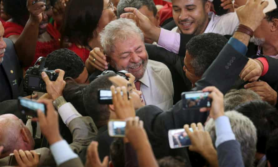 Lula greeted by supporters after his appointment as chief of staff in March.