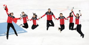 Canada celebrate after winning the figure skating team event.