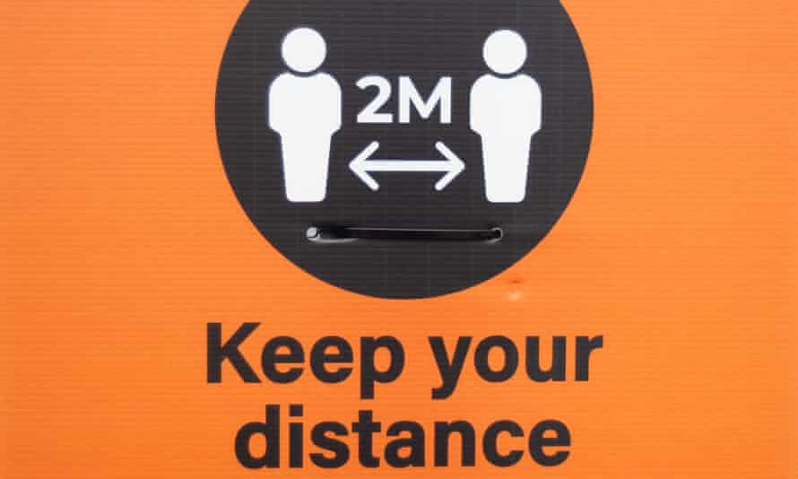 A sign reminding people to socially distance.