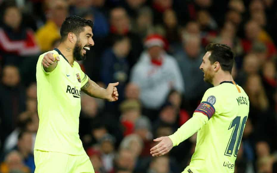 Suárez celebrates with Messi during the first leg of Barcelona's Champions League quarter-final win over Manchester United.