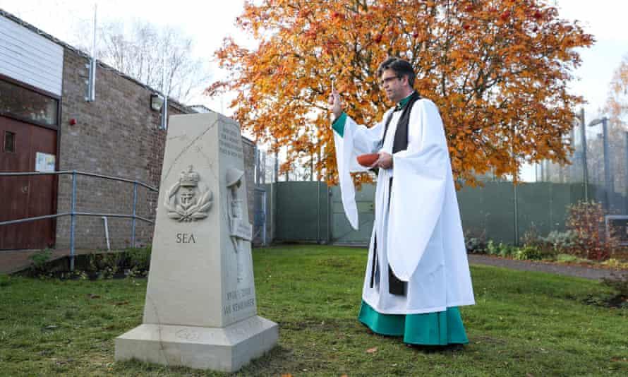 Nicholas Papadopulos blesses a war memorial outside Erlestoke prison in Wiltshire