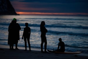 Surfers rest after an evening of activity