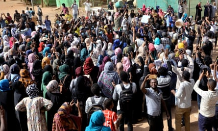 Sudanese demonstrators chant slogans as they participate in anti-government protests in Khartoum.