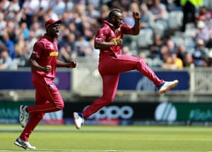 Andre Russell celebrates after taking the wicket of Usman Khawaja for 13.