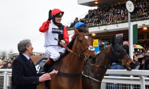 Victoria Pendleton on Pacha Du Polder waves to the crowd after coming fifth in the Foxhunter Chase at Cheltenham.