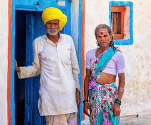 Life Partners (Karnataka, India). A man and his transgender wife stand in front of the home they have shared for 40 years in Karnataka, India.