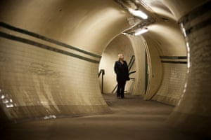A visitor surveys a passage at Aldwych underground station