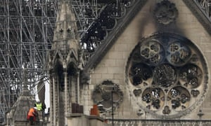 Experts inspect the fire damaged Notre Dame cathedral in Paris.