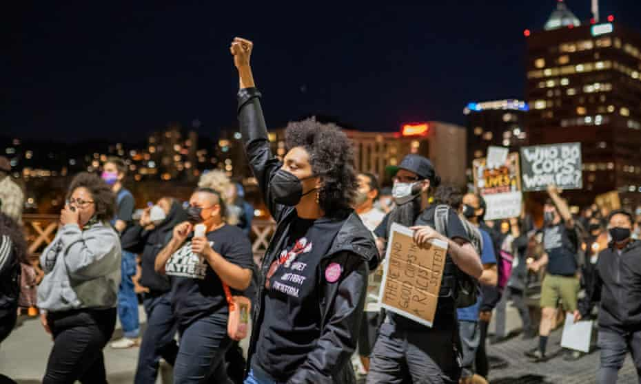 Protesters march along the Hawthorne Bridge after the police shooting of Robert Delgado.