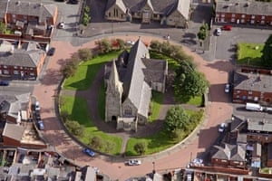 Oldham, Greater Manchester. A church in a roundabout on a housing estate