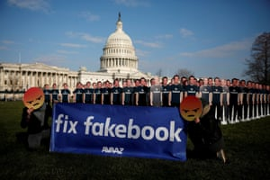 Protesters outside the US Capitol in Washington as Mark Zuckerberg testifies about Facebook's privacy policies.