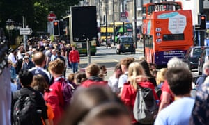 Festival-goers mingle with shoppers and tourists on Princes Street in Edinburgh.
