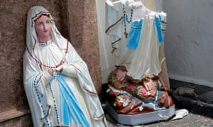 A statue of Virgin Mary broken in two parts is seen in front of the St. Anthony's Shrine, Kochchikade church