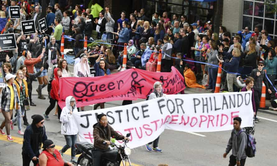 Black Lives Matter protesters block the Twin Cities Pride Parade along Hennepin Ave in Minneapolis.