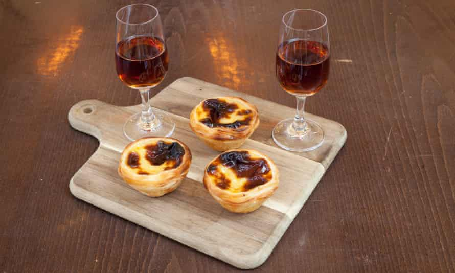 'Burnished tarts in their cups of pure flaky pastry': pastéis de nata, and a couple of glasses of madeira.