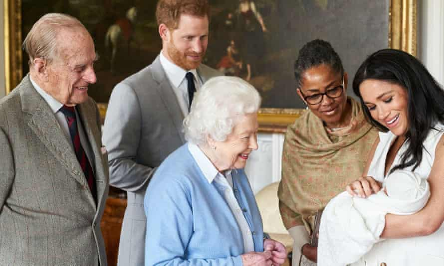 The Queen and Duke of Edinburgh meet royal baby Archie, held by Meghan as Prince Harry and Meghan's mother, Doria Ragland, look on.
