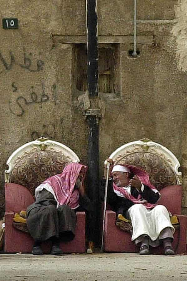 Saudi men chat outside their homes in the poor Riyadh district of al-Shamissi.