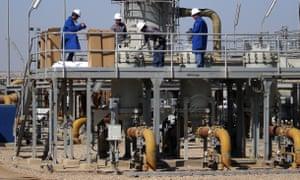 Oil workers at a West Qurna oilfield near Basra, Iraq.
