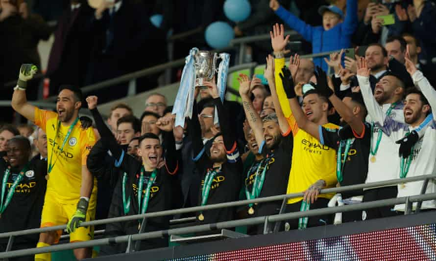 Manchester City players celebrate victory at Wembley as they made it four major domestic trophies in a row.