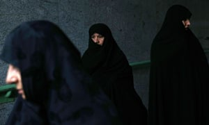 Iranian women leave after the Eid al-Fitr prayers in Tehran, Iran,