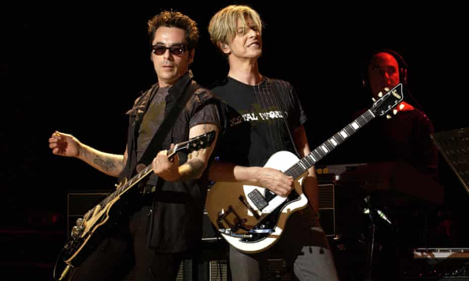 Slick with Bowie in 2003.