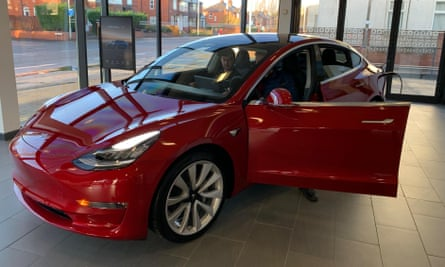 The Tesla Model 3 car on display in a showroom in Manchester