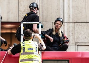 An activist is removed from a DLR train at Canary Wharf