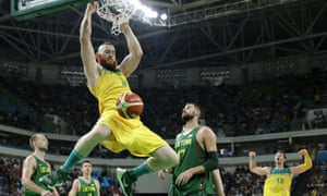 Aron Baynes dunks the ball over Lithuania's Jonas Valanciunas.